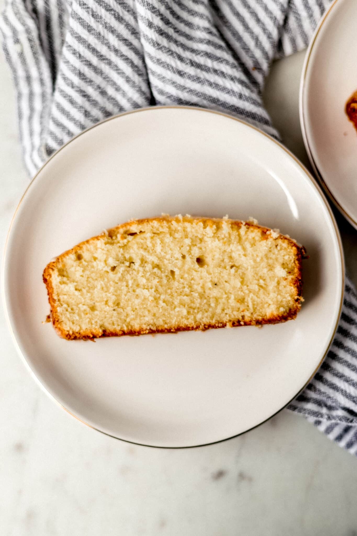slice of eggnog pound cake on a plate with a napkin