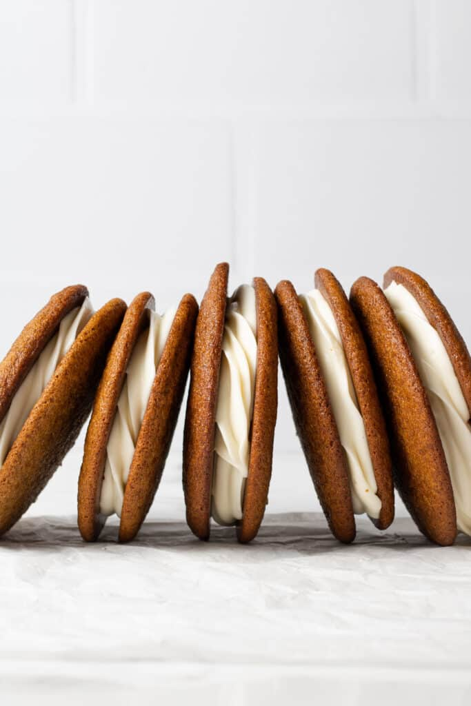 row of gingerbread whoopie pies beside each other