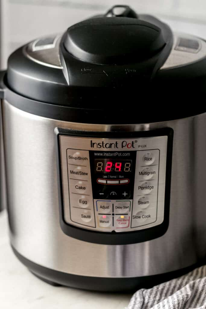 close up side view of instant pot with time set to 24