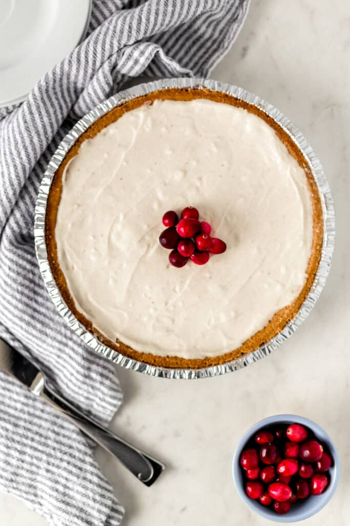 No Bake Eggnog Cheesecake topped with fresh cranberries