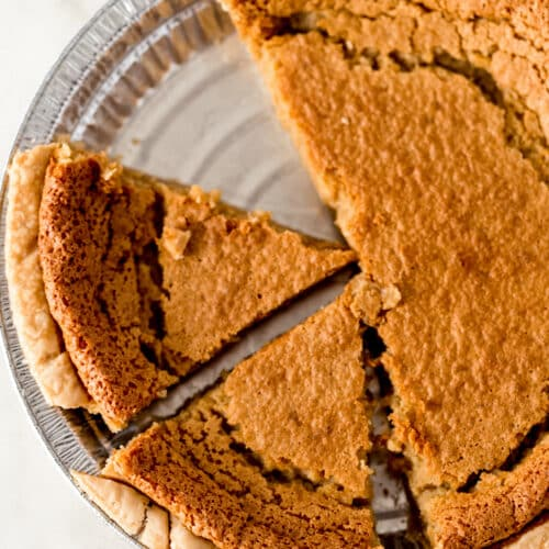 brown sugar pie cut into slices in dish