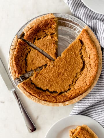 overhead view brown sugar pie with white plates and knife