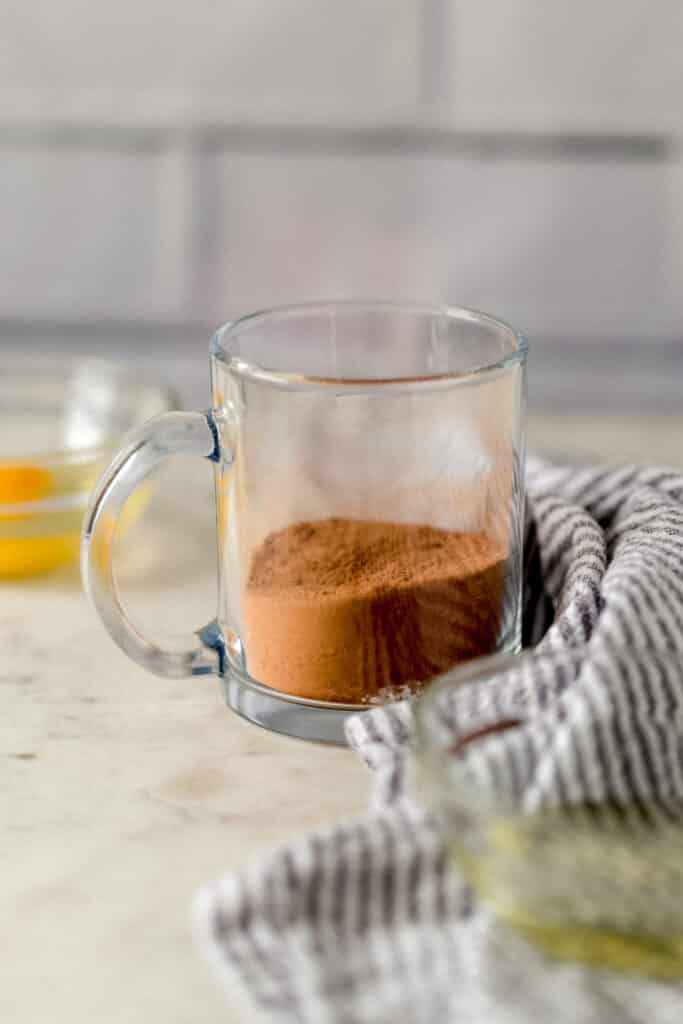 dry ingredients for microwave mug brownie in a glass mug