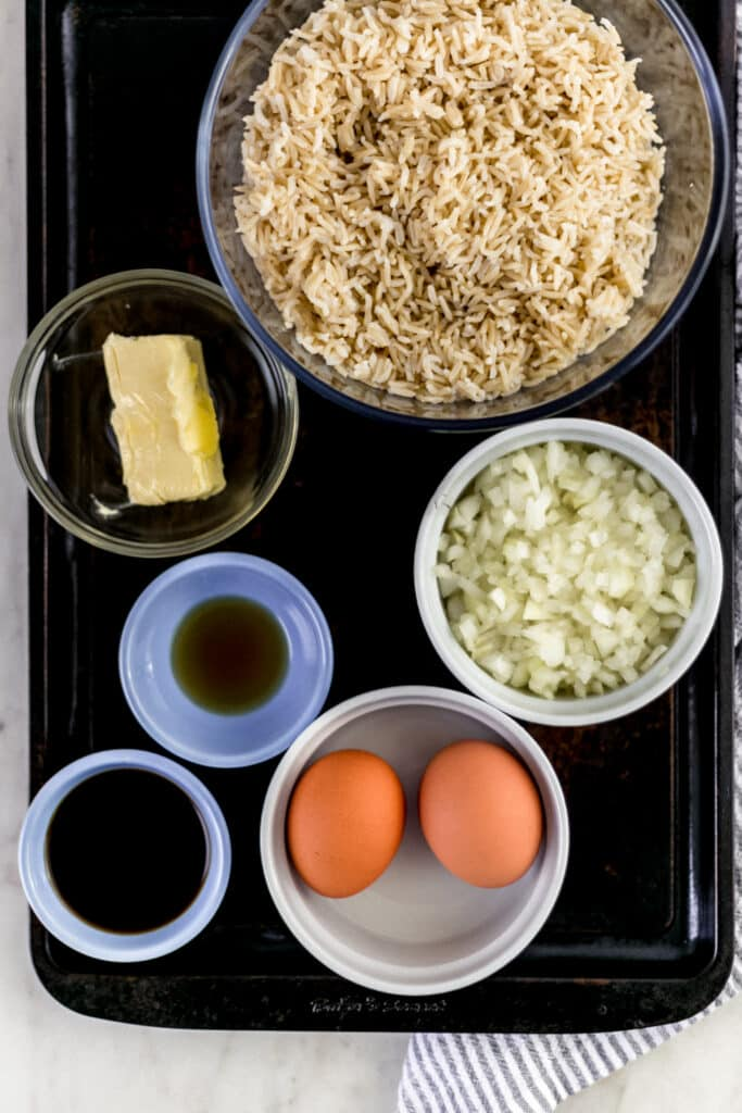 ingredients for hibachi rice on sheet pan in small bowls