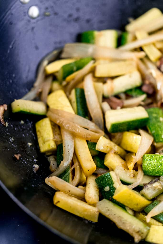 cooked hibachi style vegetables in a wok