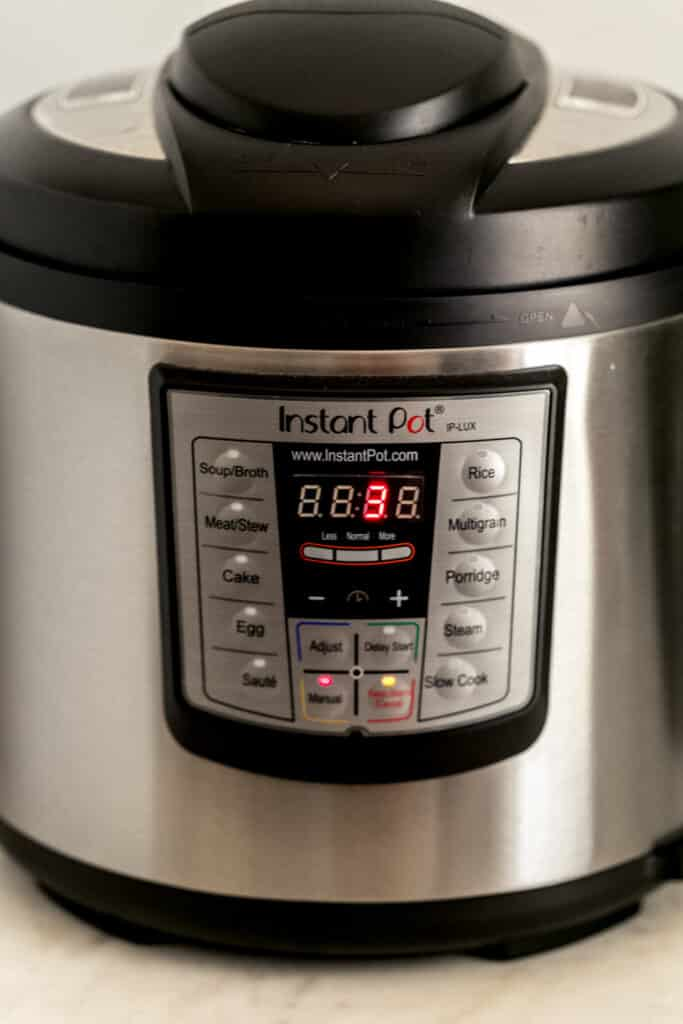 side view of instant pot set to 3 minutes cook time