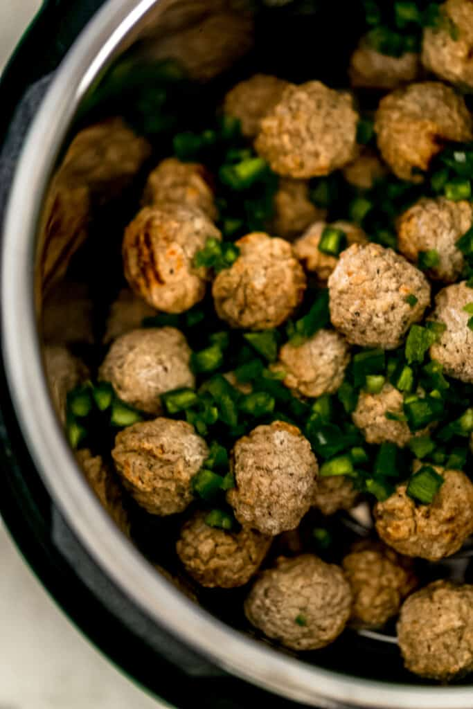 frozen meatballs and diced jalapenos inside instant pot pressure cooker