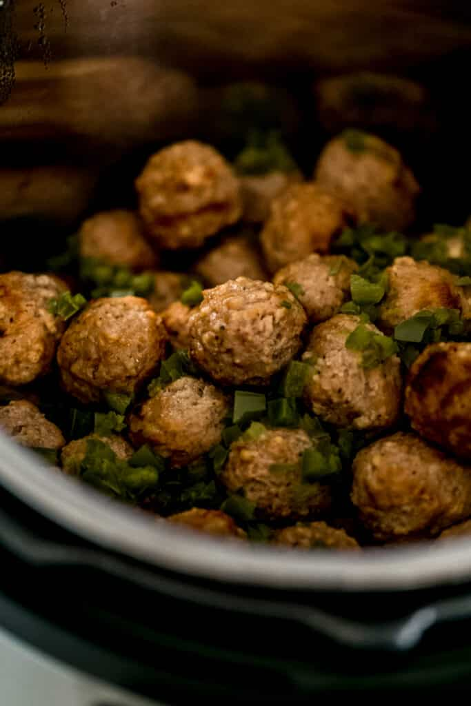 cooked meatballs and diced jalapenos in pressure cooker