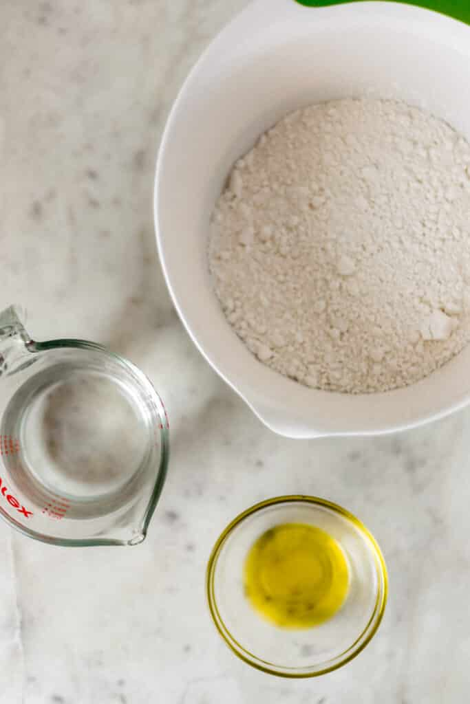 ingredients for yeast free pizza dough in bowls