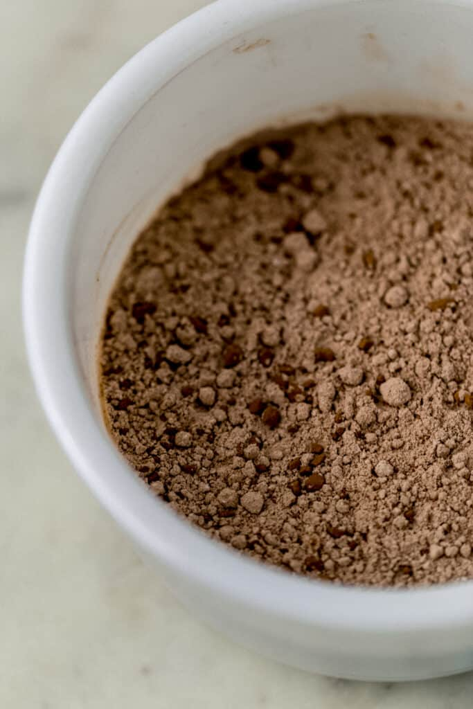 flour and cocoa powder mixture for chocolate sugar cookies in a white mixing bowl