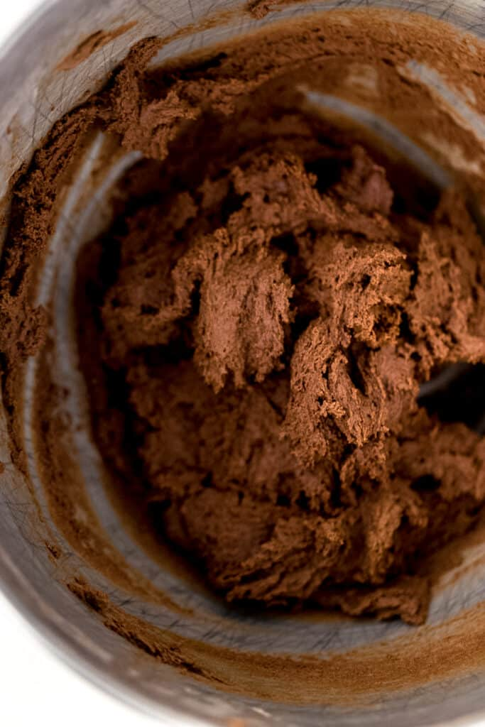 flour and cocoa mixture added to stand mixer bowl with the rest of the chocolate sugar cookie ingredients.