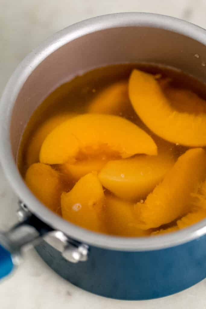 ingredients for peach tea simple syrup in sauce pan