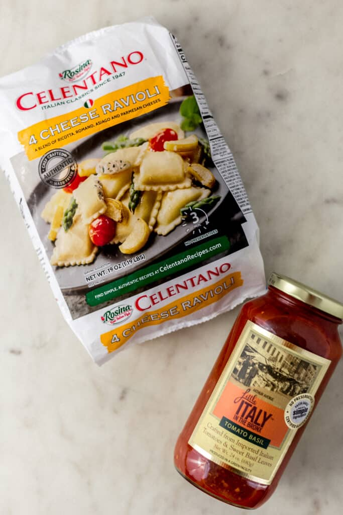 frozen ravioli package and jar of pasta sauce