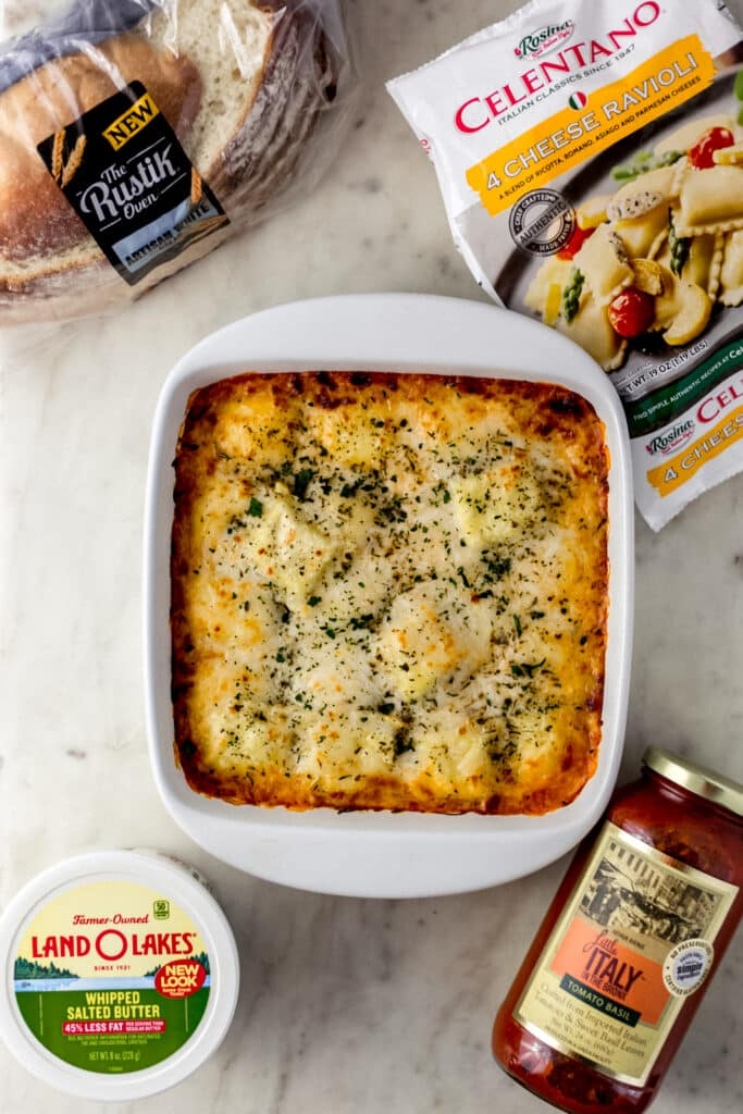 baked ravioli in baking dish with items to make the meal around it.