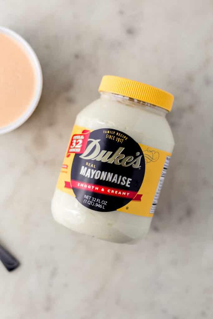 jar of Duke's mayonnaise on marble surface