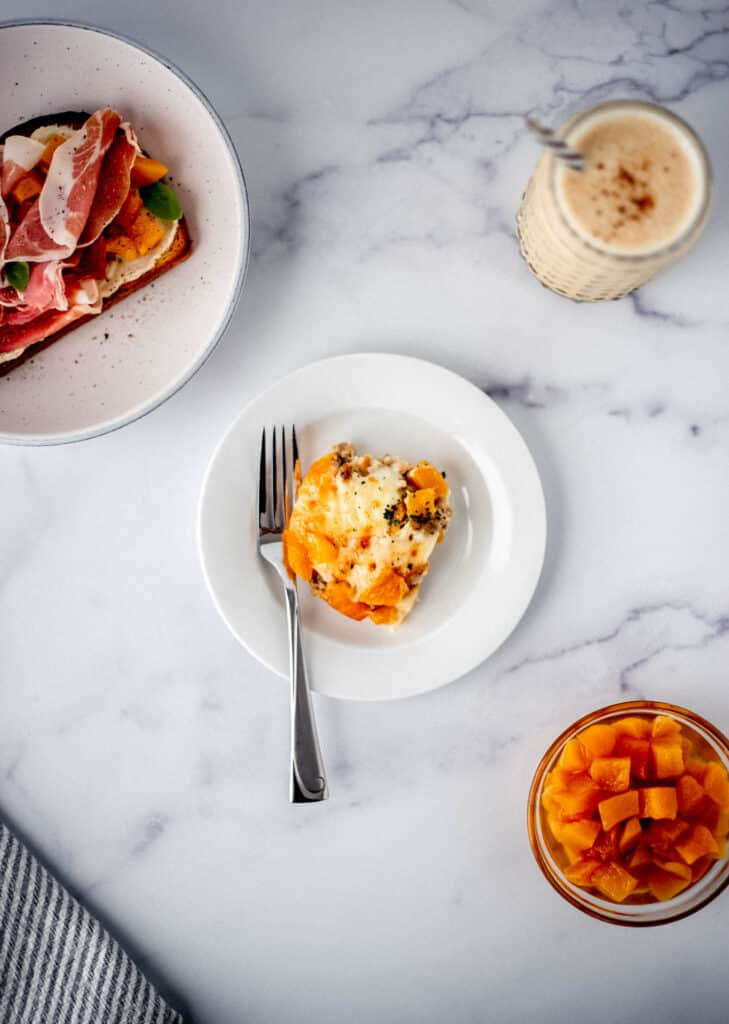 overhead view of breakfast recipes made with peaches on marble surface