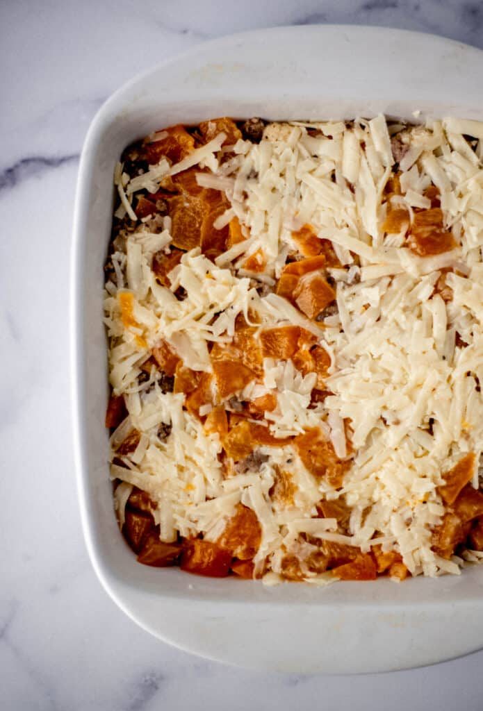 square white baking dish with unbaked ingredients.