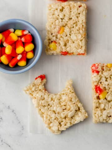 rice krispie treats with small blue bowl with candy corn