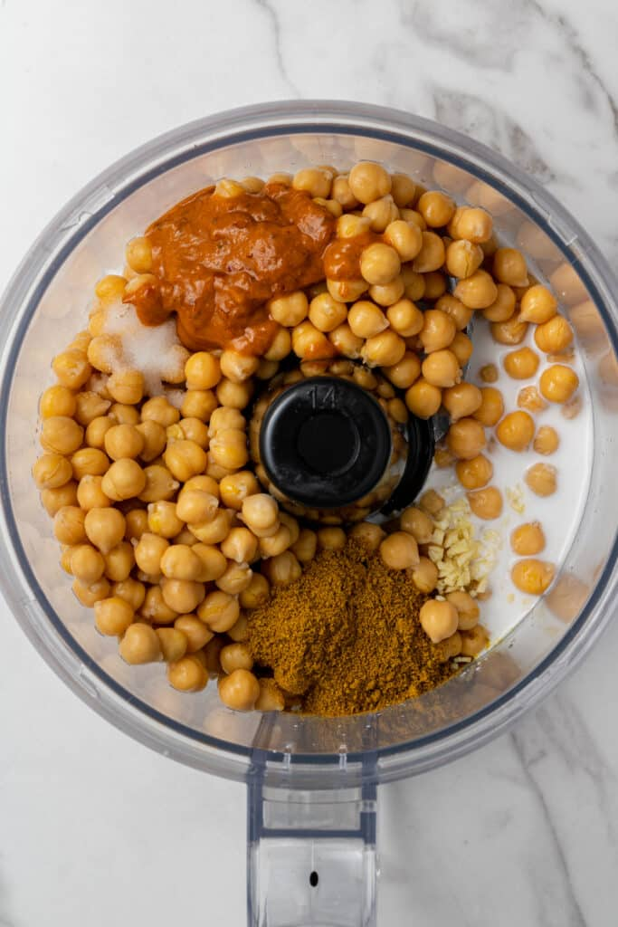 all ingredients to make hummus added into food processor