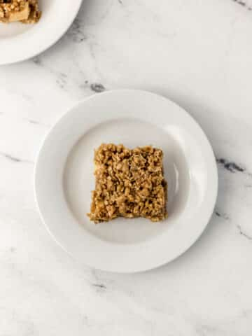 overhead view on apple crumble bar on white plate